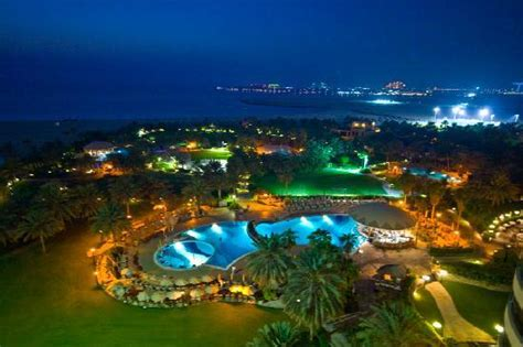 """grounds at night with views of """"the palm and the Atlantis"""