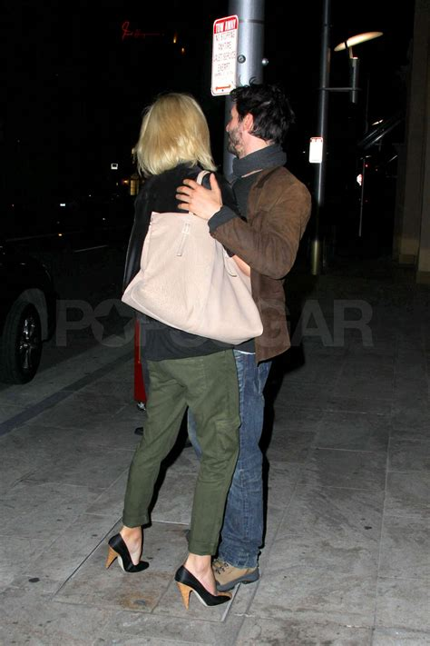 Pictures of Keanu Reeves and Charlize Theron Hugging and